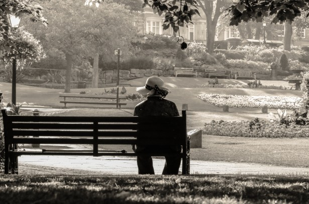 woman-sitting-alone-on-a-bench